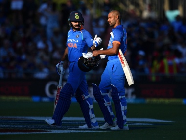 Virat Kohli walks from the field with Shikhar Dhawan after the sun angle halted play during first ODI between New Zealand and India at McLean Park in Napier. AFP