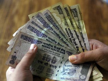 Rupee pares early gains settles 1 paise lower at 7087 amid weak macro economic data on domestic front
