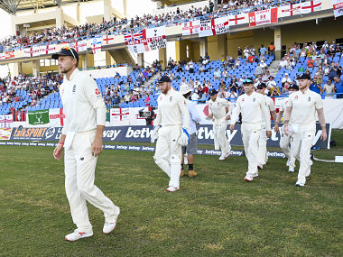 Joe Root (L) of England leads the team onto the field during day 2 of the 2nd Test between West Indies and England at Vivian Richards Cricket Stadium in North Sound, Antigua and Barbuda, on February 1, 2019. (Photo by Randy Brooks / AFP)
