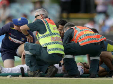 Medical staff tend to Dimuth Karunaratne after the opening batsman was felled by a Pat Cummins bouncer. AP
