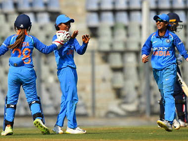 Ekta Bisht (C) celebrates with teammates Taniya Bhatia (L) and Jemimah Rodrigues (R) after taking the wicket of England's Danielle Wyatt in 1st ODI. AFP