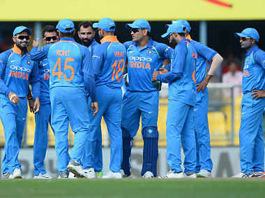 Indian cricket team players celebrate the dismissal of West Indies batsman Chandrapaul Hemraj during the first one day international (ODI) cricket match between India and West Indies at Barsapara Cricket Stadium in Guwahati on October 21, 2018. (Photo by SAJJAD HUSSAIN / AFP) / ----IMAGE RESTRICTED TO EDITORIAL USE - STRICTLY NO COMMERCIAL USE----- / GETTYOUT