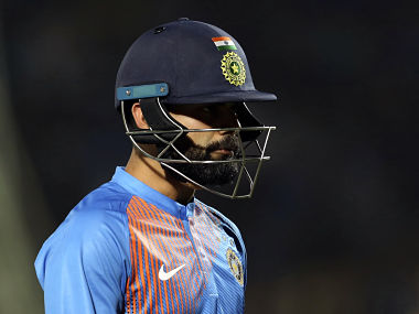 Virat Kohli walks back after holing out in the deep off Adam Zampa in the 1st T20I against Australia. AP