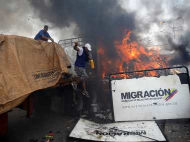 Venezuela Two killed as Maduro loyalists block aid convoy with tear gas bullets Guaido says president doesnt care for citizens