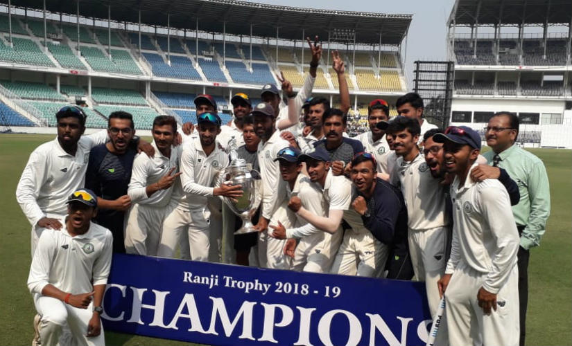 The victorious Vidarbha team pose with the trophy after beating Saurashtra by 78 runs. Twitter/@nitin_gadkari
