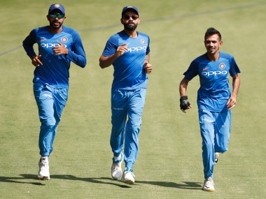 India captain Virat Kohli with teammates Jasprit Bumrah, left, and Yuzvendra Chahal during a training session ahead of 2nd T20I. AP