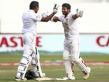 Kusal Perera (R) celebrates the victory with Vishawa Fernando (L) after hitting the winning runs on the fourth day of the first Test. AFP