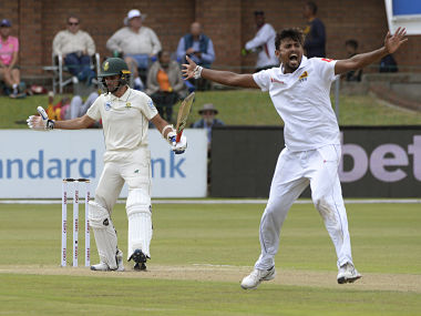 Sri Lanka's Suranga Lakmal (R) appeals for LBW call on South Africa's Keshav Maharaj during the second day of their Test cricket match between South Africa and Sri Lanka, at St. George's Park Stadium in Port Elizabeth, on February 22, 2019. - This match is the second test in the two test series, with Sri Lanka having won the first. (Photo by RODGER BOSCH / AFP)