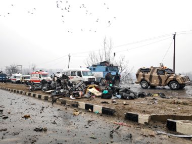 Pulwama blast aftermath Attack triggers violence in Jammu as mobs torch vehicles attack Kashmiri Muslims