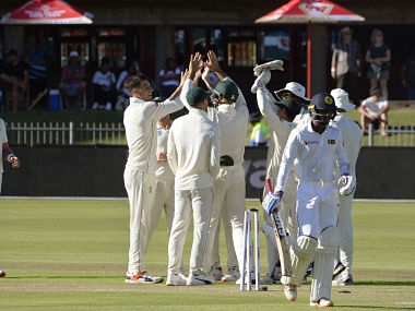 South African players celebrate after Sri Lanka's Oshada Fernando (R) was bowled out during the second test cricket match between South Africa and Sri Lanka at Saint George's Park stadium on February 21, 2019, in Port Elizabeth. (Photo by RODGER BOSCH / AFP)