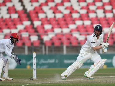 Ireland's Paul Stirling guides one through behind point against Afghanistan. AFP