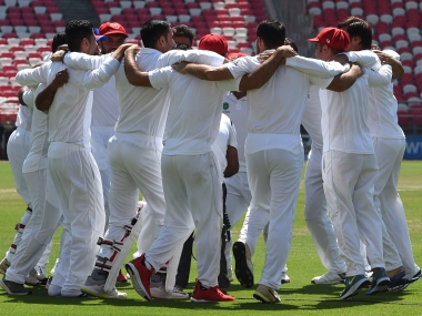 Members of the Afghanistan team celebrate after their maiden Test win over Ireland. AFP