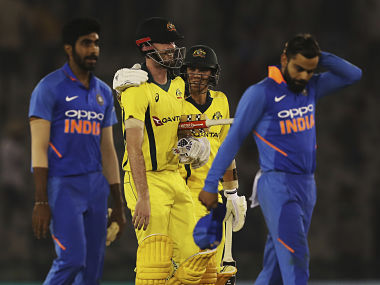 India's captain Virat Kohli (R) and Jasprit Bumrah (L) walk back in disappointment as Ashton Turner takes Australia home with a stunning knock in Mohali. AP