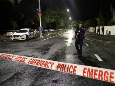 A police officer patrols at a cordon near a mosque in central Christchurch, New Zealand.