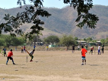 Local playing cricket in Dili, the capital of East Timor. AFP
