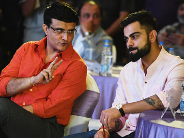 Indian cricket captain Virat Kohli (R) looks on as former captain Sourav Ganguly gestures during a cricket book launch function in Kolkata on April 7, 2018. (Photo by Dibyangshu SARKAR / AFP)