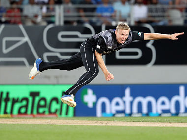 New Zealand's Scott Kuggeleijn bowls during the second Twenty20 international cricket match between New Zealand and India in Auckland on February 8, 2019. (Photo by MICHAEL BRADLEY / AFP)