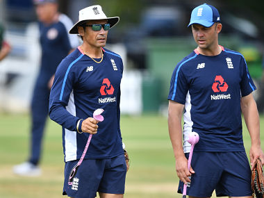 Member of England's coaching team Mark Ramprakash (L) attends a training session at Lord's Cricket Ground in London on August 8, 2018 ahead of the second Test cricket match between England and India. (Photo by BEN STANSALL / AFP)