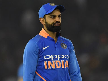 Indian cricet captain Virat Kohli walks back to the pavilion after the fourth one-day international (ODI) cricket match between India and Australia at the Punjab Cricket Association Stadium in Mohali on March 10, 2019. (Photo by Prakash SINGH / AFP) / ----IMAGE RESTRICTED TO EDITORIAL USE - STRICTLY NO COMMERCIAL USE-----