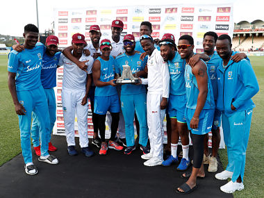 West Indies players celebrate with the Wisden Trophy after beating England 2-1 in Test series. Reuters