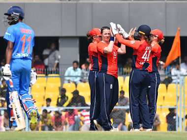 England's Anya Shrubsole (C) celebrates with her team mates after taking the wicket of India's Taniya Bhatia during the second match of the women's Twenty20 (T20) cricket series between India and England at the Barsapara Cricket Stadium in Guwahati on March 7, 2019. (Photo by Biju BORO / AFP) / ----IMAGE RESTRICTED TO EDITORIAL USE - STRICTLY NO COMMERCIAL USE-----