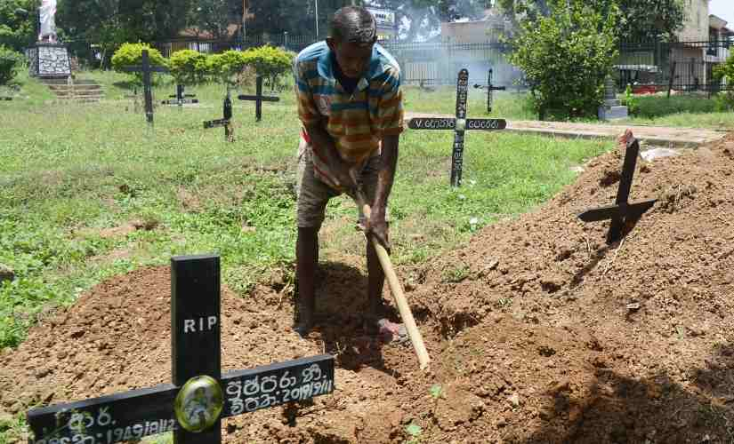 Sri Lanka blasts Grave digger speaks of struggle to steady hands while preparing to bury infant