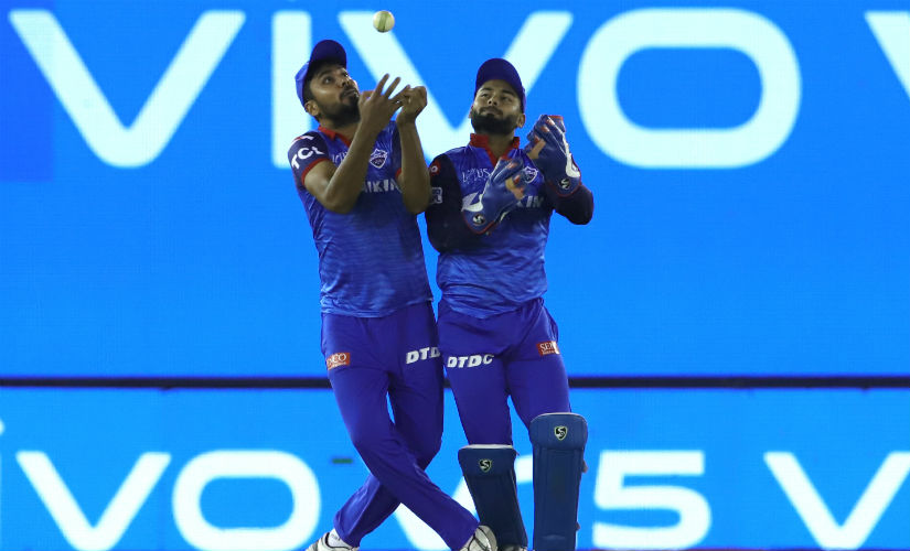 Avesh Khan and Rishabh Pant almost contrived to drop the catch, but Khan caught the rebound off Pant's gloves. Image: Sportzpics