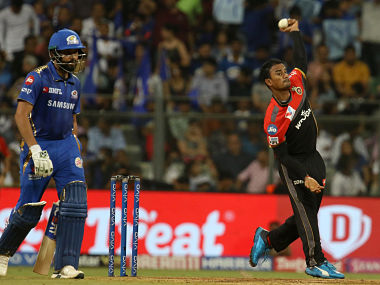 RCB bowler Pawan Negi in action against Mumbai Indians. Sportzpics