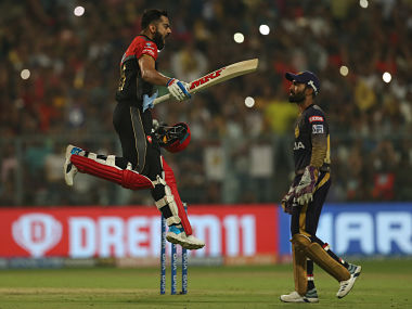 Royal Challengers Bangalore captain Virat Kohli celebrates after scoring 100 against KKR. Sportzpics