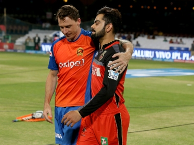 Royal Challengers Bangalore skipper Virat Kohli with Gujarat Lions player Dale Steyn during match 57 (Qualifier 1) of the Vivo IPL ( Indian Premier League ) 2016 between the Gujarat Lions and the Royal Challengers Bangalore held at The M. Chinnaswamy Stadium in Bangalore, India, on the 24th May 2016 Photo by Faheem Hussain / IPL/ SPORTZPICS
