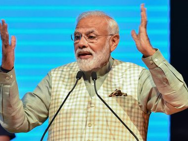 Narendra Modi promises collateralfree loan insurance pension in reelection pitch to business community