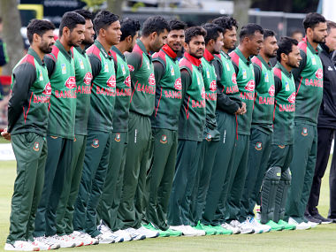 Bangladesh cricketers stand during the playing of the national anthem before the Tri-Nation Series, one-day international between Ireland and Bangladesh at the Clontarf Cricket Club Ground in Clontarf, Dublin on May 15, 2019. (Photo by Paul Faith / AFP)