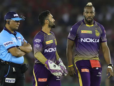 Dinesh Karthik captain of Kolkata Knight Riders talks with Andre Russell during their match against KXIP. Sportzpics