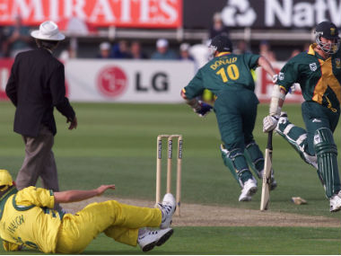 South African batsman Lance Klusener (R) and Allan Donald meet at the same wicket after Donald failed to run, allowing Australia victory in a World Cup cricket semi-final. Reuters