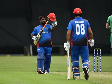 Mohammad Shahzad (L) celebrates after scoring 100 against Ireland. Image courtesy: Twitter @ACBofficials