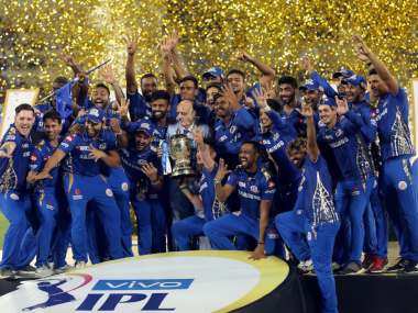 Mumbai Indians' players with IPL 2019 trophy. Sportzpics