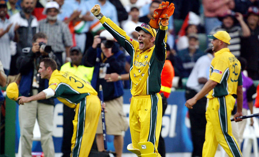 Australian wicketkeeper Adam Gilchrist (C) celebrates as Damien Martyn (L) bows to the crowd and Andrew Symonds (R) looks on after Australia won the final of the ICC Cricket World Cup played at the Wanderers Stadium in Johannesburg 23 March 2003. Batting first, Australia scored 359-2 from their 50 overs, their highest ever one-day total and then dismissed India for 234 to win by 125 runs. AFP PHOTO/William WEST (Photo by WILLIAM WEST / AFP)