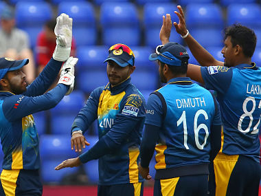Sri Lanka's Kusal Mendis (L) celebrates with bowler Sri Lanka's Suranga Lakmal (R) and Sri Lanka's captain Dimuth Karunaratne (2R) after taking the wiclet of South Africa's JP Duminy (unseen) for 22 runs during the 2019 Cricket World Cup warm up match between Sri Lanka and South Africa at Sophia Gardens stadium in Cardiff, south Wales, on May 24, 2019. (Photo by GEOFF CADDICK / AFP)