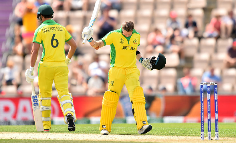 Australia's Steve Smith (R) celebrates reaching his century during the 2019 Cricket World Cup warm up match between England and Australia at the Rose Bowl in Southampton, southern England, on May 25, 2019. (Photo by Glyn KIRK / AFP)