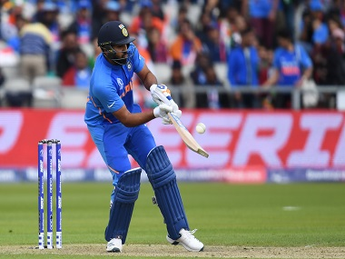 India's Rohit Sharma plays a shot during the 2019 Cricket World Cup group stage match between India and Pakistan at Old Trafford in Manchester, northwest England, on June 16, 2019. AFP
