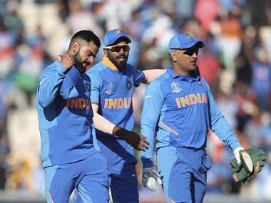 India's captain Virat Kohli, left, celebrates their win as he leaves the field with teammates at the end of the Cricket World Cup match between India and Afghanistan at the Hampshire Bowl in Southampton, England, Saturday, June 22, 2019. (AP Photo/Aijaz Rahi)