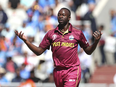 West Indies' Kemar Roach celebrates the dismissal of India's Rohit Sharma. AP