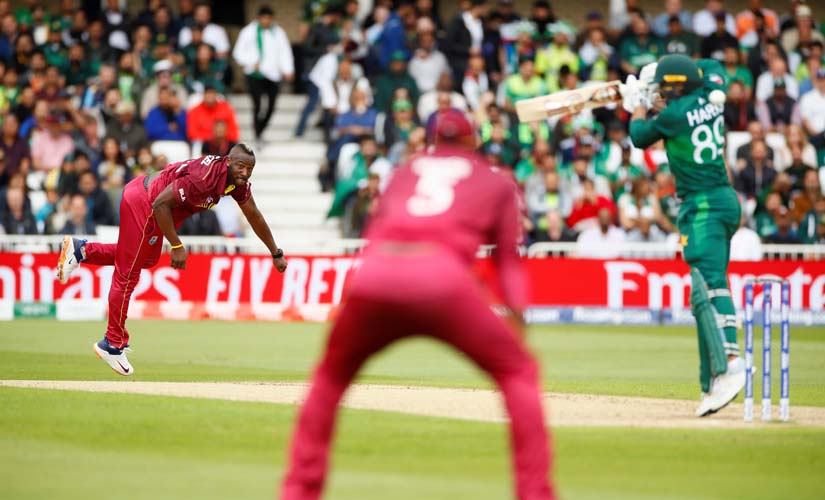 Andre Russell bowls a bouncer to Haris Sohail. Reuters
