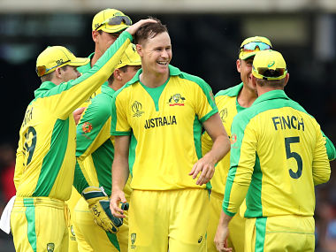 Australia's Jason Behrendorff celebrates with teammates after taking the wicket of England's Jofra Archer. Reuters