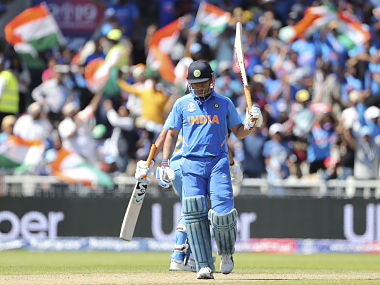 India's MS Dhoni raises his bat to celebrate scoring fifty runs during the Cricket World Cup match between India and West Indies at Old Trafford in Manchester, England, Thursday, June 27, 2019. (AP Photo/Aijaz Rahi)