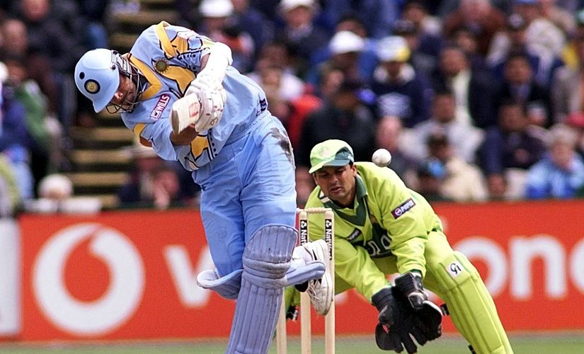 Indian batsman Rahul Dravid flicks a ball from Saqlain to leg as Pakistani keeper Moin Kahn looks on during their Cricket World Cup match at Old Trafford in Manchester 08 June 1999. UK OUT (Photo by OWEN HUMPHREYS / PA / AFP)