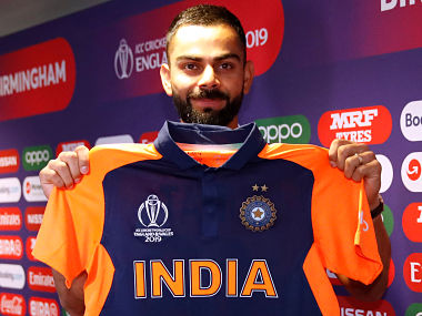Cricket - ICC Cricket World Cup - India Press Conference - Edgbaston, Birmingham, Britain - June 29, 2019 India's Virat Kohli poses with his shirt during a press conference Action Images via Reuters/Andrew Boyers - RC156C292780