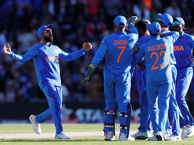 Indian players celebrate winning the World Cup match against Afghanistan. Reuters