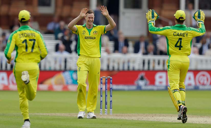 Australia's Jason Behrendorff, centre, celebrates taking the wicket of England's Jofra Archer. AP