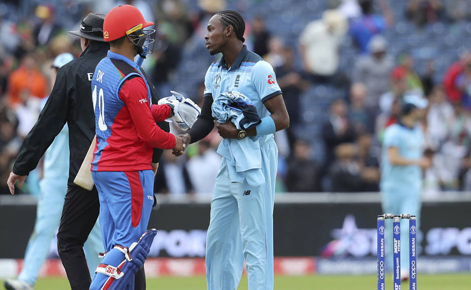 Jofra Acher and Dawlat Zadran shake hands as England beat Afghanistan by 150 runs. The Afghans remained winless in the tournament after five matches. AP